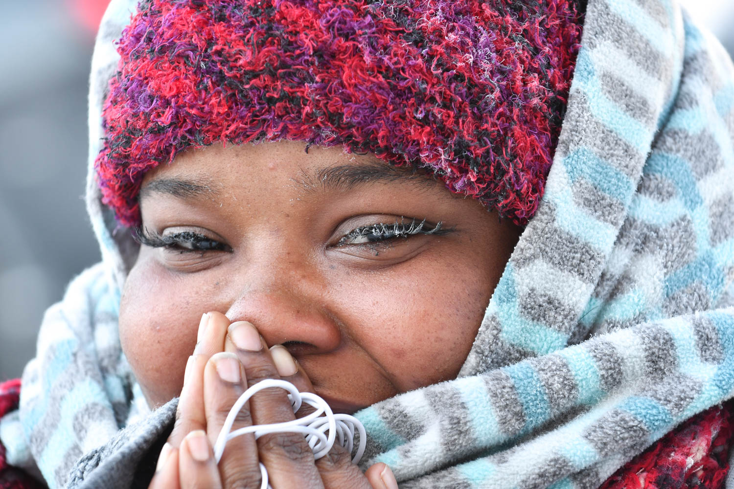 Ice forms on the eyelashes of Aubreyanne Edwards, of Rock Island, as she braves minus 27 windchill while walking to The Fort Armstrong Wednesday, Jan. 30, 2019, in Rock Island. (Todd Mizener - Dispatch/Argus)