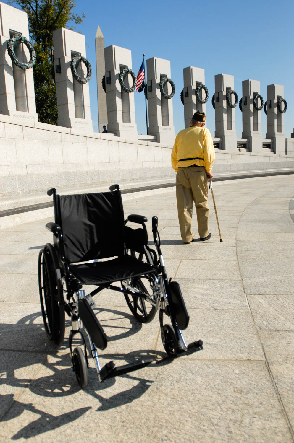 World War II veteran Joe Colmer, of East Moline, leaves his wheelchair behind as he takes a moment to himself while visiting the World War II Memorial in Washington D.C. on Nov. 1, 2008.  Colmer, a veteran of D-Day and other major battles during the war, was among 96 local veterans who traveled to the nation's capital to visit the World War II Memorial as part of Honor Flight of the Quad Cities. (Todd Mizener - Dispatch/Argus)