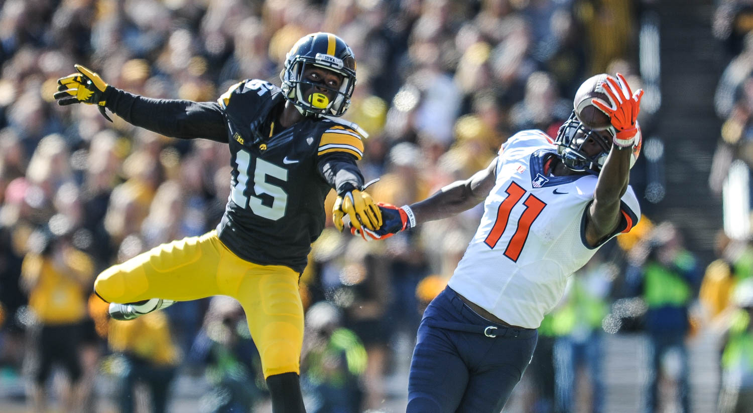 Illinois wide receiver Malik Turner eyes a catch ahead of Iowa defender Joshua Jackson during the first half of their game Saturday, October 10, 2015, at Kinnick Stadium in Iowa City. Iowa defeated the Illlini, 29-20.  (Todd Mizener - Dispatch/Argus)