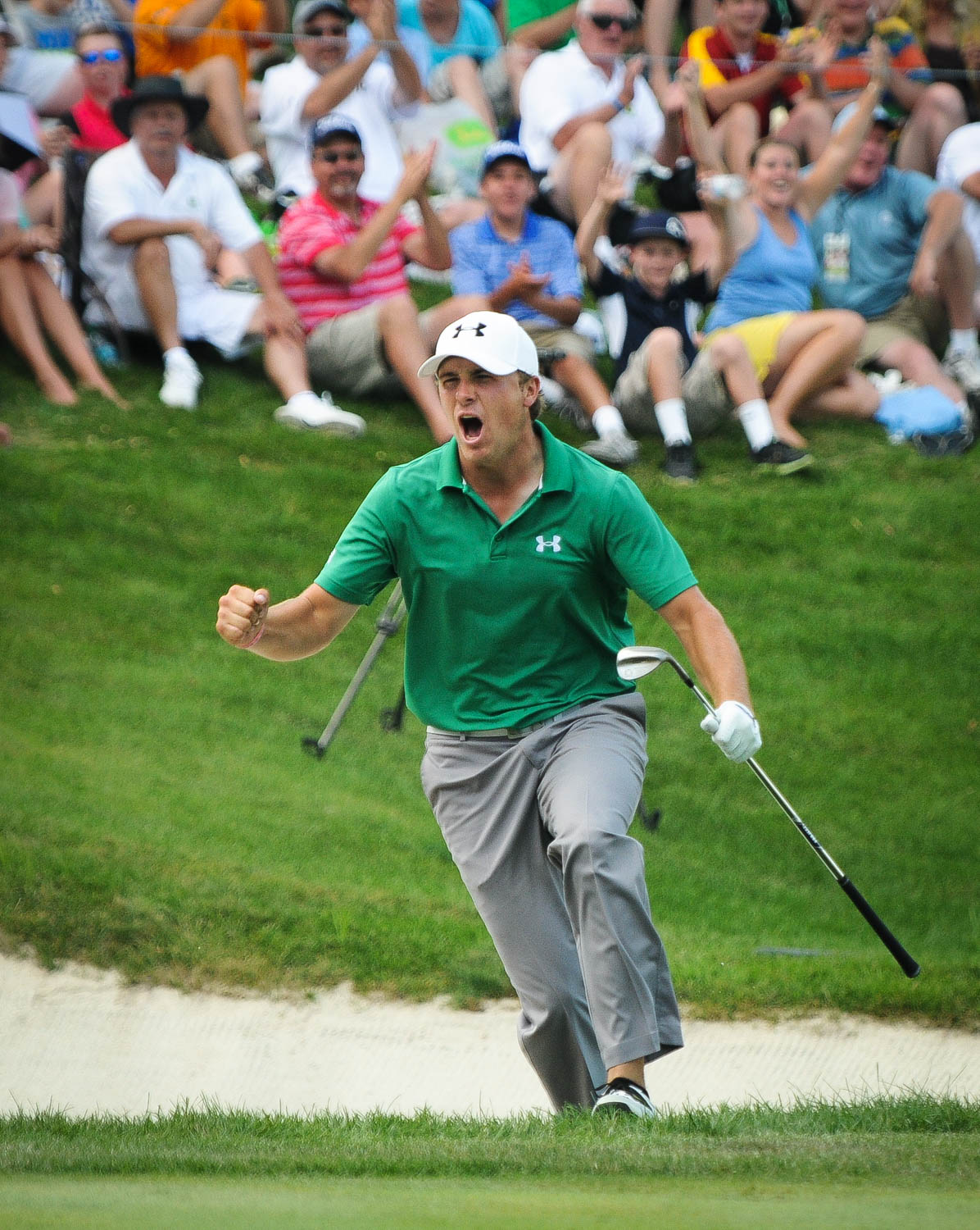 PGA Tour pro Jordan Spieth reacts to chipping in from the bunker for a birdie on the 18th hole during the final round of the John Deere Classic golf tournament in Silvis, Ill., Sunday, July 14, 2013. Spieth won the tournament on the 5th playoff hole. (Todd Mizener - Dispatch/Argus)